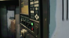 Male hand using electronic panel with remote control at metallurgical plant. Male hand press buttons and turns levers on electronic panel computer with remote stock footage