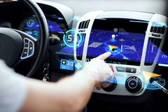 Male hand using navigation system on car dashboard Stock Photos