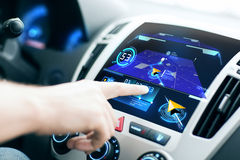 Male hand using navigation system on car dashboard Royalty Free Stock Photos