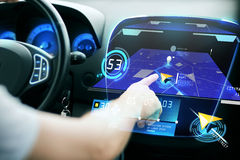 Male hand using navigation system on car dashboard Stock Images