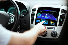 Male hand using navigation system on car dashboard Royalty Free Stock Photography