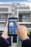Male hand using smart home app at home Royalty Free Stock Photo