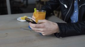 Male hand using smartphone in cafe 4K.  stock footage