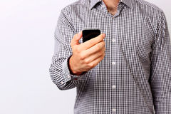 Male hand using smartphone Royalty Free Stock Image