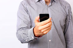 Male hand using smartphone Royalty Free Stock Images