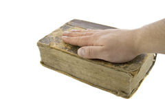 Male hand on the vintage bible. Isolated over white royalty free stock image