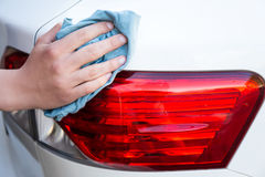 Male hand washing car with microfiber cloth Royalty Free Stock Image