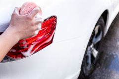 Male hand washing car with sponge. And soap Stock Photos