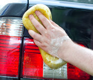 Male hand washing car Stock Photos