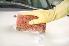 Male hand washing white car Stock Photos