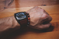 Male hand with the watch and bracelet. Modern man in casual style. Male hand with the watch and bracelet Royalty Free Stock Photo