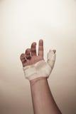 Male hand wearing wrist splint. Male hand wearing a wrist splint for a sprained hand Stock Photography