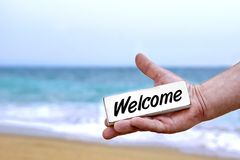 Male Hand with WELCOME signboard Royalty Free Stock Images