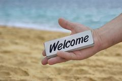 Male Hand with WELCOME signboard Royalty Free Stock Image