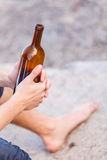 Male hand with wine bottle outdoor Royalty Free Stock Photos