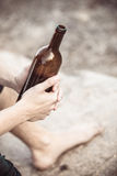 Male hand with wine bottle outdoor Royalty Free Stock Image