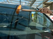 Wipe and clean a car window. Male hand wiping and cleaning a car window Royalty Free Stock Photos