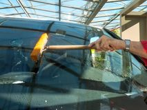 Wipe and clean a car window. Male hand wiping and cleaning a car window Stock Images