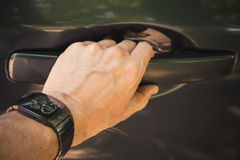 Male hand with wirst watch opens car door Stock Photography