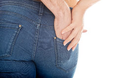 Male hand in woman's jeans pocket. Stock Photography