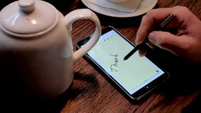 Male hand writes thank you text on the smart phone screen stock video
