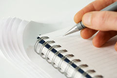 Male hand writing in notebook. Close-up of male hand writing in notebook Royalty Free Stock Photography