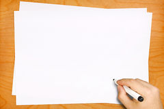 Male Hand Writing on Blank White Sheets Royalty Free Stock Image