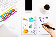 Male hand writing business plan Stock Photos