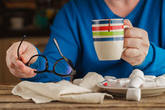 Male hand writing in diary and holding cup of hot chocolate with Royalty Free Stock Photos