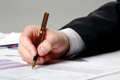 Male hand is writing in the document stock photography