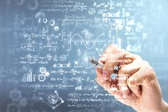 Science and algebra concept. Male hand writing mathematical formulas on blurry background. Science and algebra concept. Double exposure royalty free stock photo
