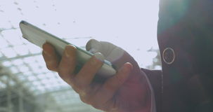 Male Hand Writing Message on Smartphone stock footage