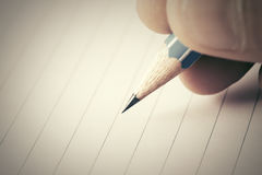 Male hand writing in notebook. Close-up of male hand writing in notebook Royalty Free Stock Image