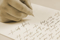 Male hand writing on a paper. See my other works in portfolio Stock Photography
