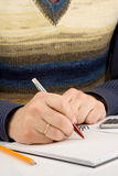 Male hand writing by pen on notebook Royalty Free Stock Image