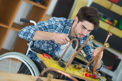 Male handicapped conductor assembler stock photo