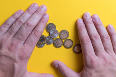 Male hands around coins. Protecting your money. Lack of money. Plan of expenses Stock Photos