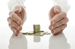 Male hands around Euro coins Royalty Free Stock Image