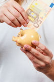 Male hands with banknote and piggybank Stock Photography