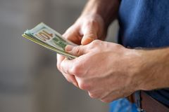 Male hands with banknotes close up. royalty free stock image
