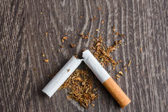 Male hands breaking a cigarette Stock Images