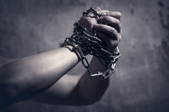 Male hands with chain. Male hands with metal chain Royalty Free Stock Photos