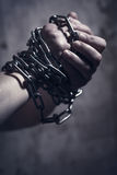 Male hands with chain. Male hands with metal chain Royalty Free Stock Photography