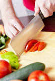 Male hands chopping vegetables Royalty Free Stock Image