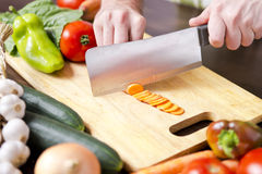 Male hands chopping vegetables Stock Photos