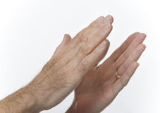 Male hands clapping. Hands raised in applause against white background Stock Photo