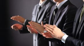 Male hands clapping on black. Side-view Royalty Free Stock Images