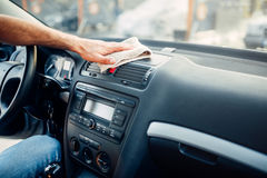 Male hands cleans auto, car dashboard polishing Stock Photo