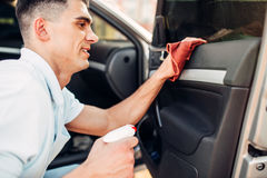Male hands cleans auto Royalty Free Stock Photography