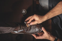 Male hands cleansing the shoe Royalty Free Stock Photography
